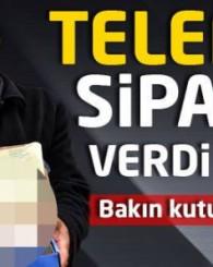 PAKETTEN TELEFON YERİNE ARAÇ LASTİK KİTİ ÇIKINCA ŞOKE OLDU