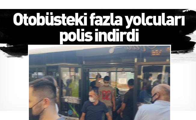 Otobüsteki fazla yolcuları polis indirdi