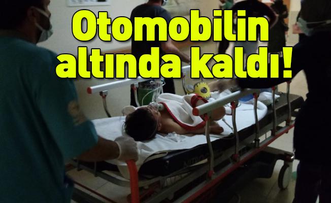 Otomobilin altında kalan minik Mustafa ağır yaralandı