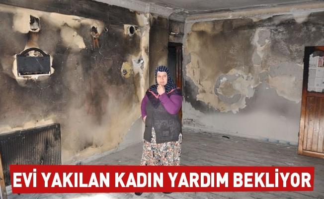 Evi yakılan kadın yardım bekliyor