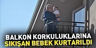 Balkon korkuluklarına sıkışan bebek kurtarıldı