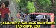 Şarampole yuvarlanan traktörden sağ kurtuldu