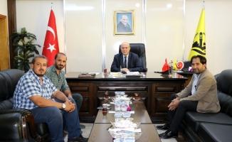 İHA Erzincan Bölge Müdürü Akbuğa, Belediye Başkanı Pekmezci'yi ziyaret etti