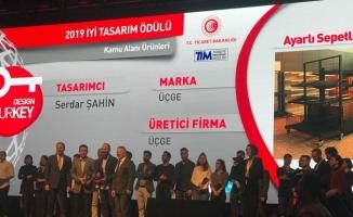 ÜÇGE Saturn raf sistemlerine Design Turkey'den çifte ödül