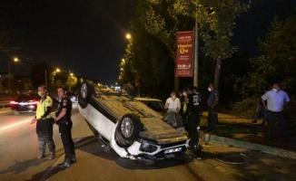 Bursa'da başka bir aracın sıkıştırması sonucu takla atan sıfır otomobil kullanılamaz hale geldi