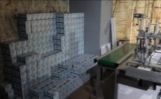İnegöl'de kaçak üretilen 152 bin maske ele geçirildi