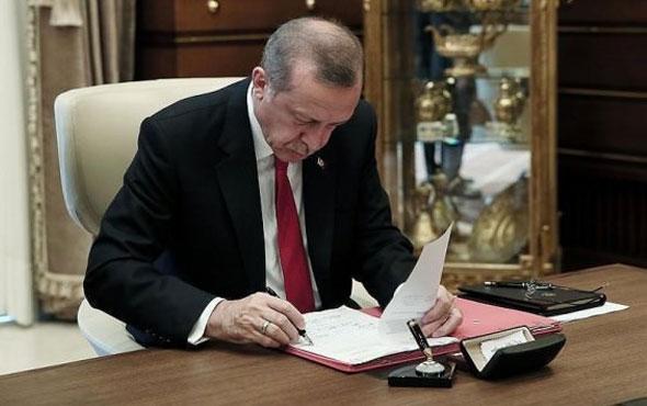 Erdoğan 10 maddelik uyum yasasını onayladı